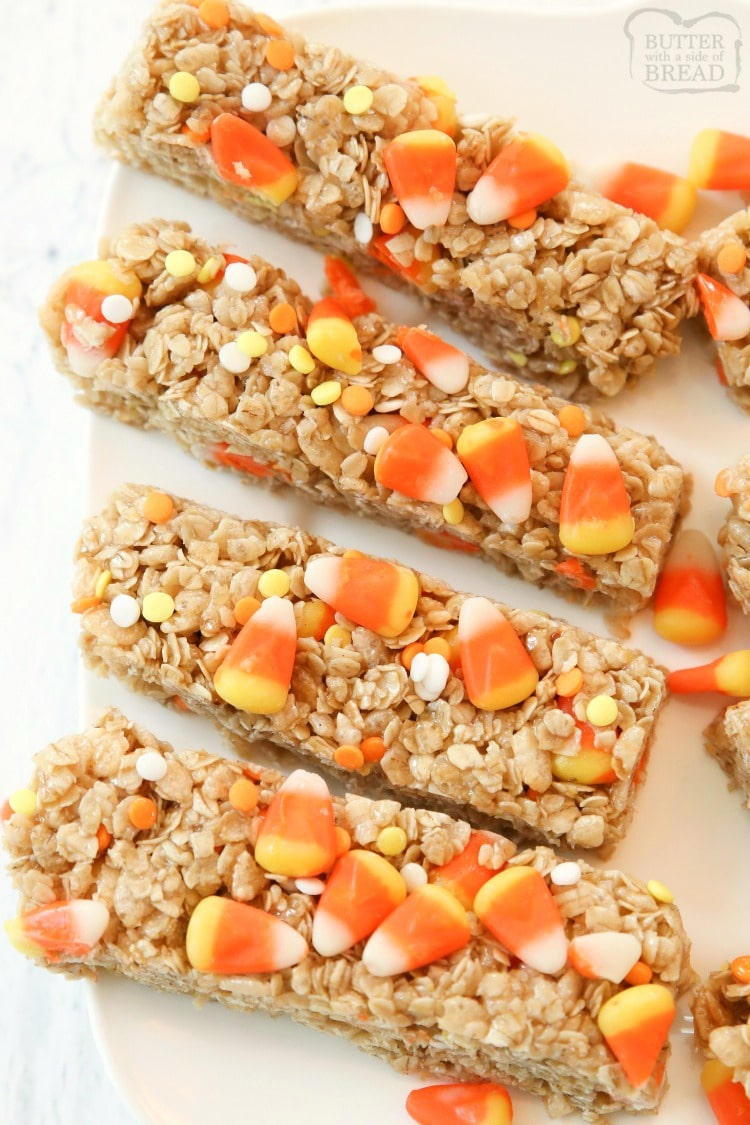 Quick & Easy Candy Corn Granola Bar recipe made in minutes. Perfect Halloween snack! Simple ingredients combined to make a tasty homemade granola bars. Fun halloween snacks made with candy corn!