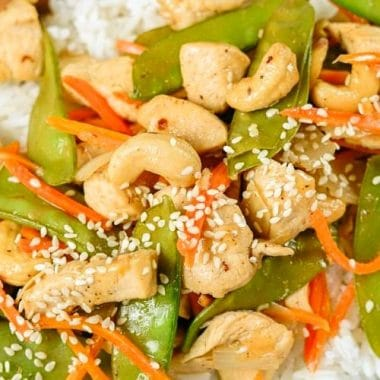 Cashew Chicken Stir Fry is a simple 30 minute meal made with tender chicken & veggies in a flavorful Asian sauce! Stay home, save your money and make up this easy homemade Cashew Chicken Recipe!