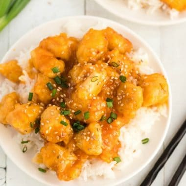 Homemade Orange Chicken made with a sweet & savory orange sauce and tender breaded chicken. This orange chicken recipe with orange marmalade is simple and perfect alongside white rice!