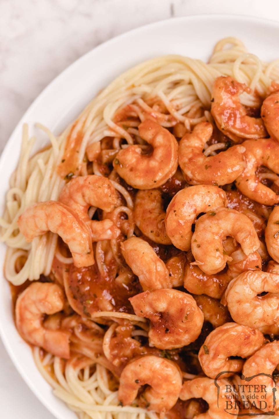 Fresh shrimp in a buttery scampi sauce over pasta