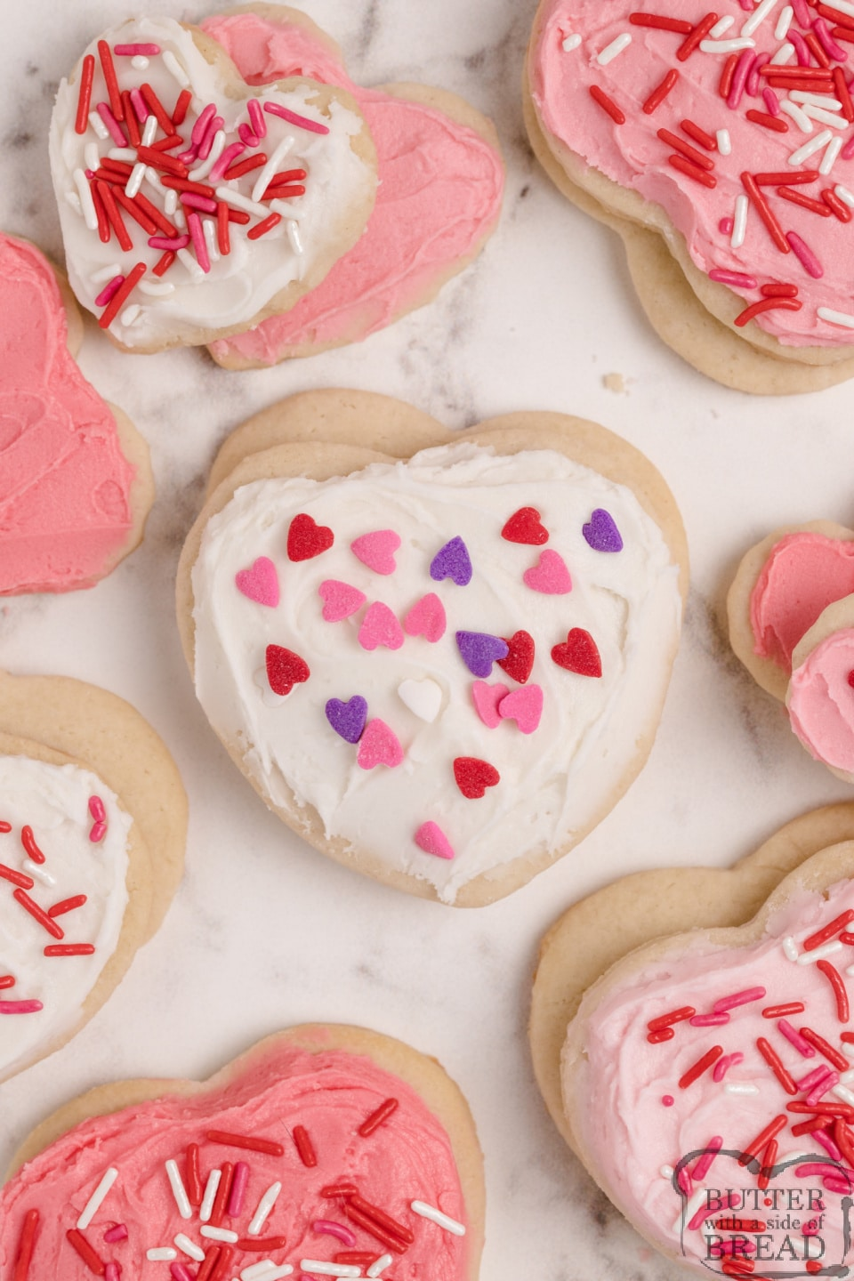 Valentines Sugar Cookies are soft, thick and easily the best sugar cookie recipe I've ever tried. These cream cheese sugar cookies are perfectly sweet and they hold their shape when baked!