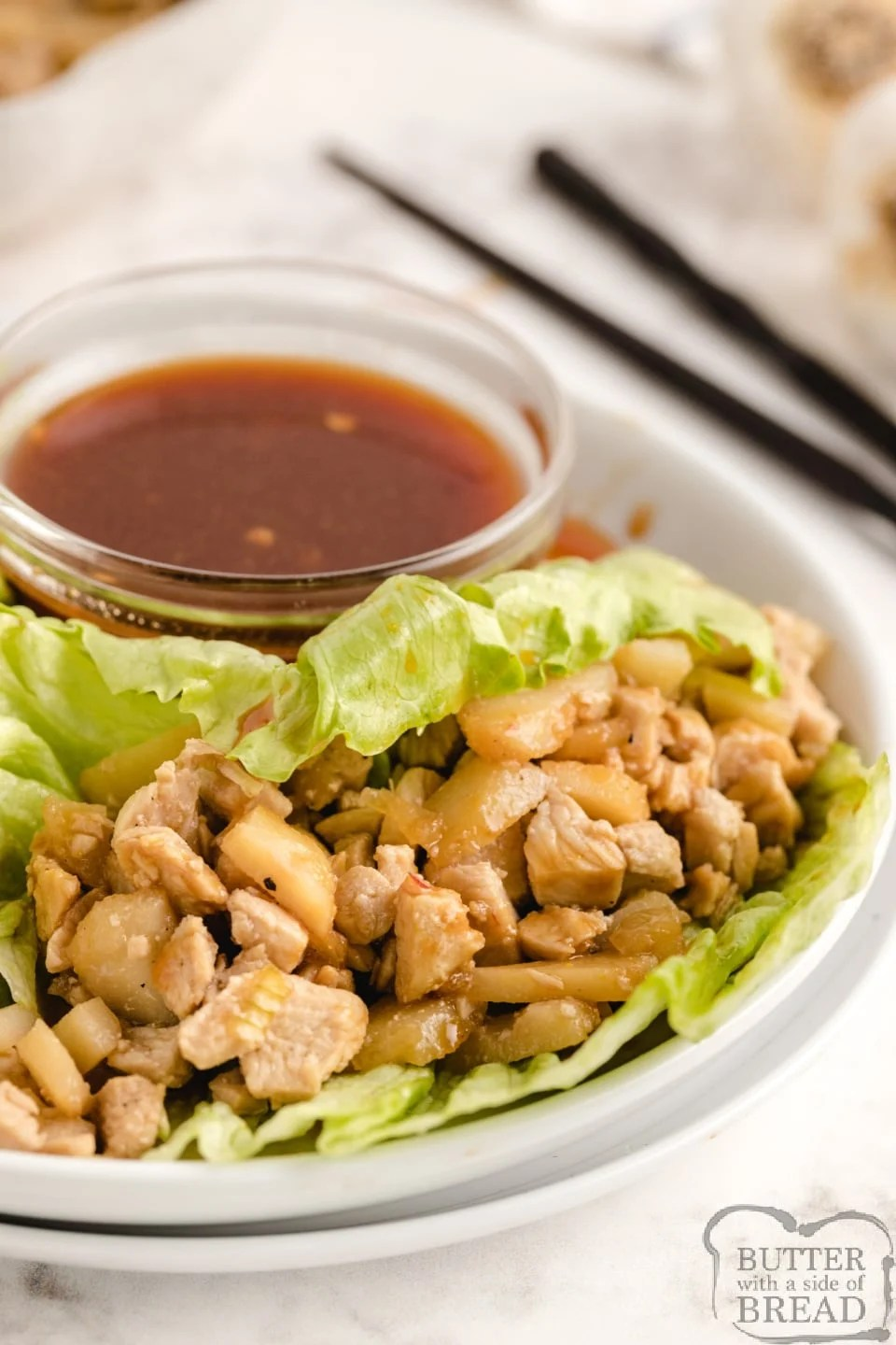 Chicken Lettuce Wraps made with chicken, water chestnuts, onion and garlic in a leaf of lettuce and then dipped in a delicious homemade Asian sauce. Easy chicken lettuce wrap recipe that is perfect as a low-carb appetizer or main dish.
