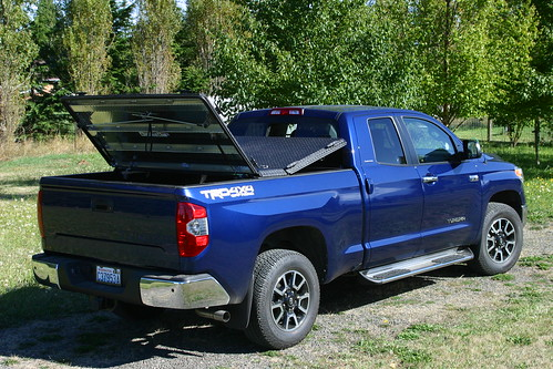 Black Heavy Duty Truck Bed Cover On Blue Toyota Tundra