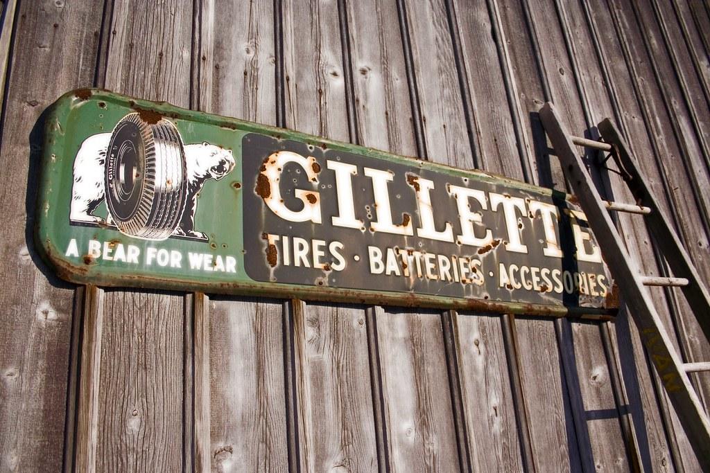 Gillette Tires A Vintage Gillette Sign Attached To A