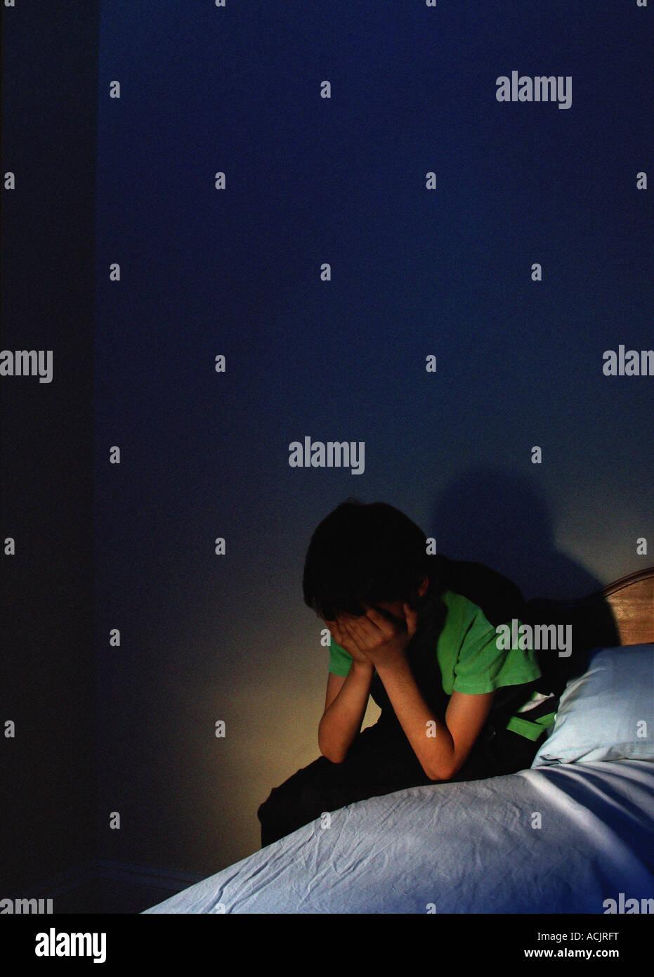 Upset boy alone at night Stock Photo, Royalty Free Image ...