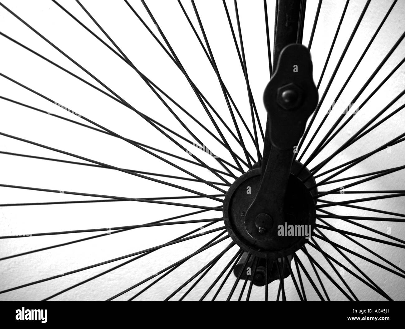 An abstract black and white photo of a wheel penny farthing stock image