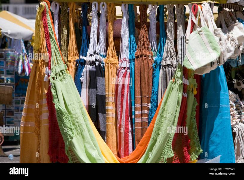 Brightly coloured cotton hammocks for sale as souvenirs for tourists     Brightly coloured cotton hammocks for sale as souvenirs for tourists in  Brazil