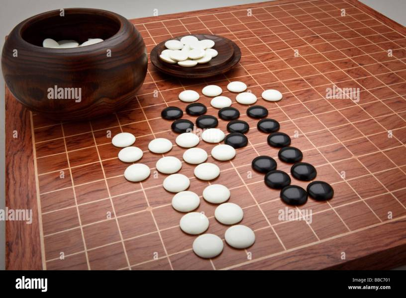 Counters and board for the Chinese board game Go  sometimes referred     Counters and board for the Chinese board game Go  sometimes referred to as  Chinese checkers