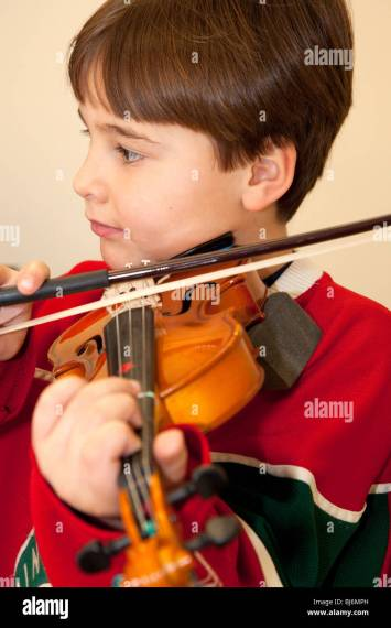 Children Violin Child Musicians Stock Photos   Children Violin Child     Boy age seven practicing violin at music lesson  St Paul Minnesota USA    Stock Image