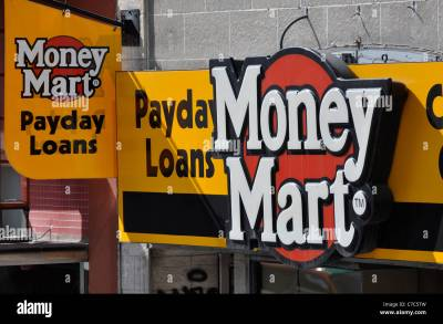 Payday Loans Sign on store front, Money Mart Stock Photo ...