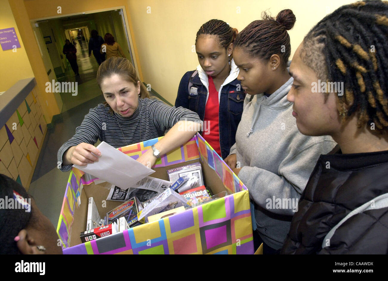 Suzanne Berkes, left, a child life specialist at Oakland ...