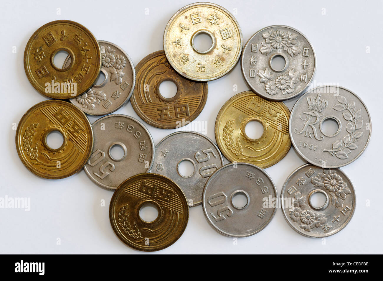 Coins with a hole in the middle Stock Photo: 43323378 - Alamy