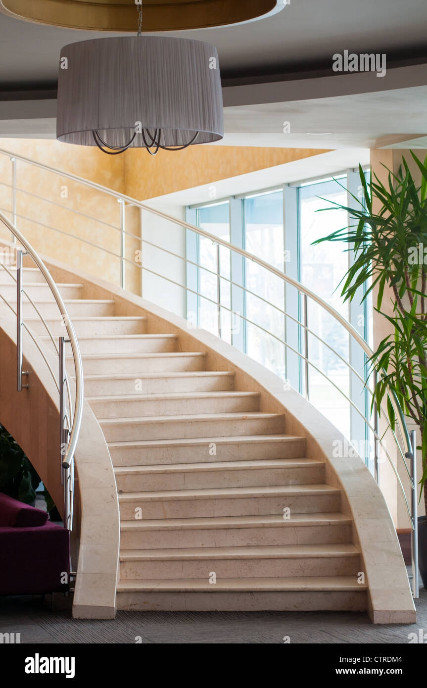 Modern Staircase In Hotel Foyer With Daylight From Window Stock | Modern Staircase Window Design | Architecture | Small House Stair | Section Window | Elegant | Wooden