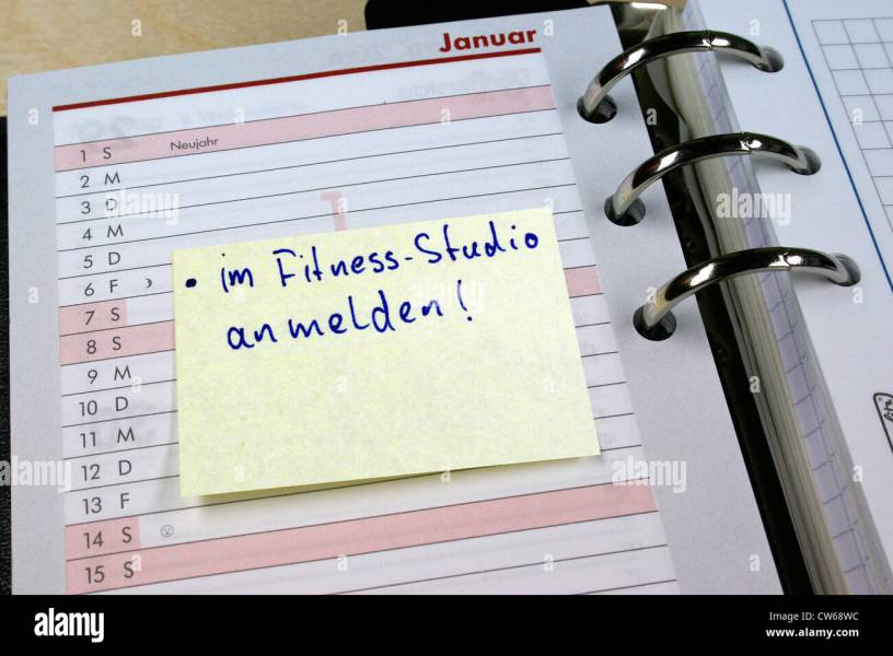 memo with  register for gym  label in diary  New Year intention     memo with  register for gym  label in diary  New Year intention