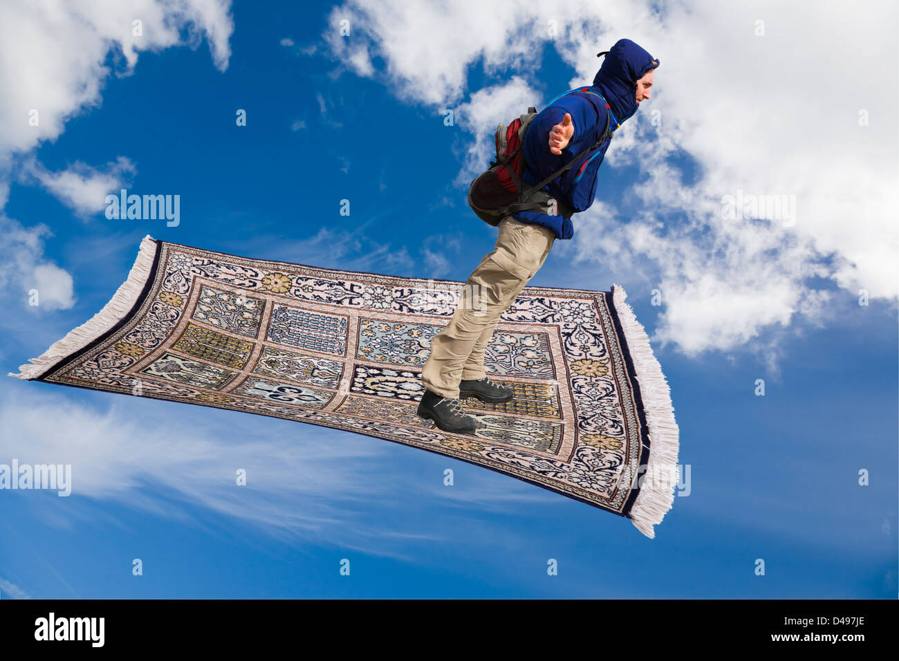 Magic Carpets Stock Photos   Magic Carpets Stock Images   Alamy Man on a magic carpet flying down across blue sky with white clouds    Stock