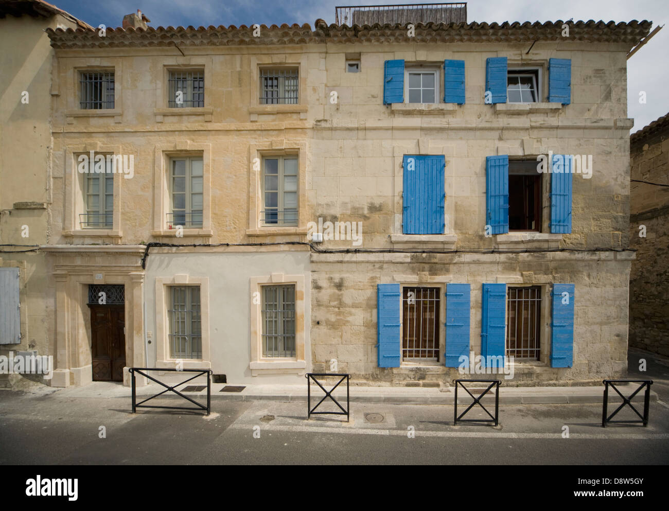 Two adjoining old stone 3-storey houses in Arles, France ...