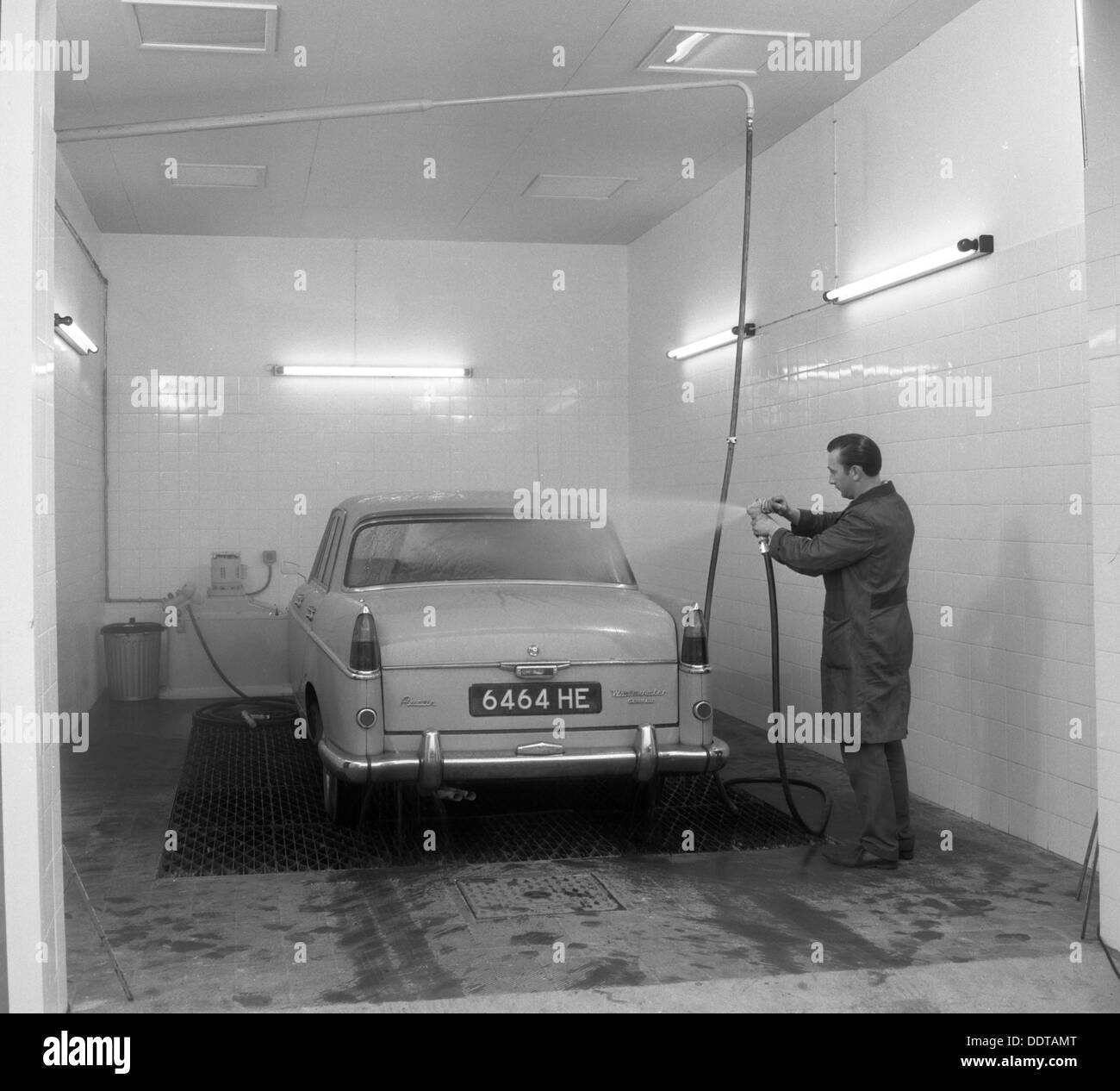 A 1961 Austin Westminster in a car wash  Grimsby  1965  Artist Stock     A 1961 Austin Westminster in a car wash  Grimsby  1965  Artist  Michael  Walters