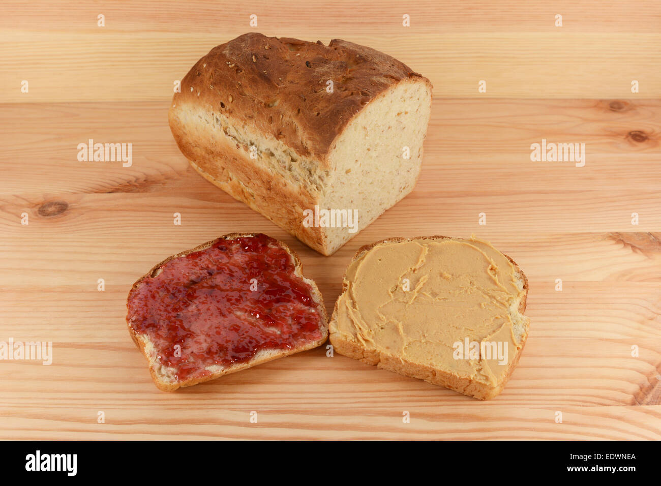 Cut Loaf Of Fresh Oat And Linseed Bread With Jam And