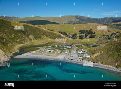 Ohariu Bay, Makara Beach, and holiday houses, near ...