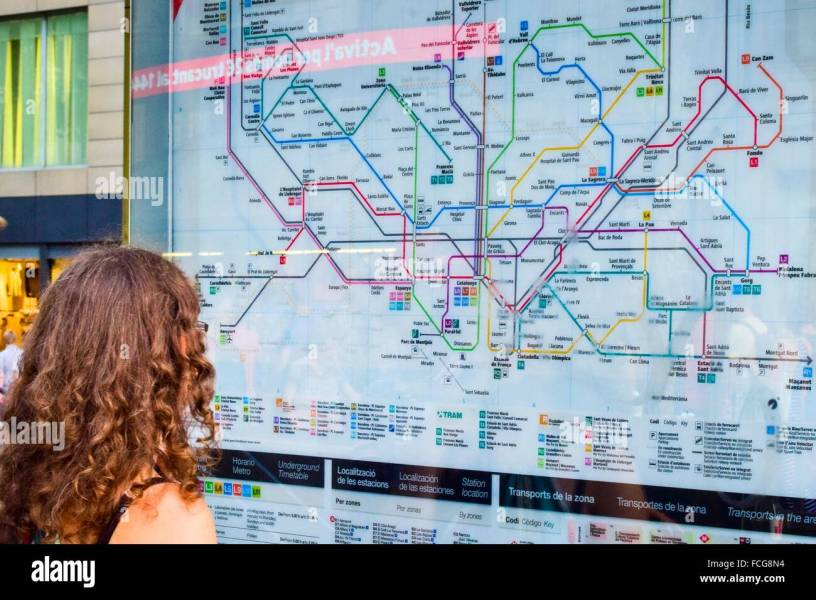 Subway Map Stock Photos   Subway Map Stock Images   Alamy Woman looking at a subway map  Barcelona  Catalonia  Spain    Stock Image