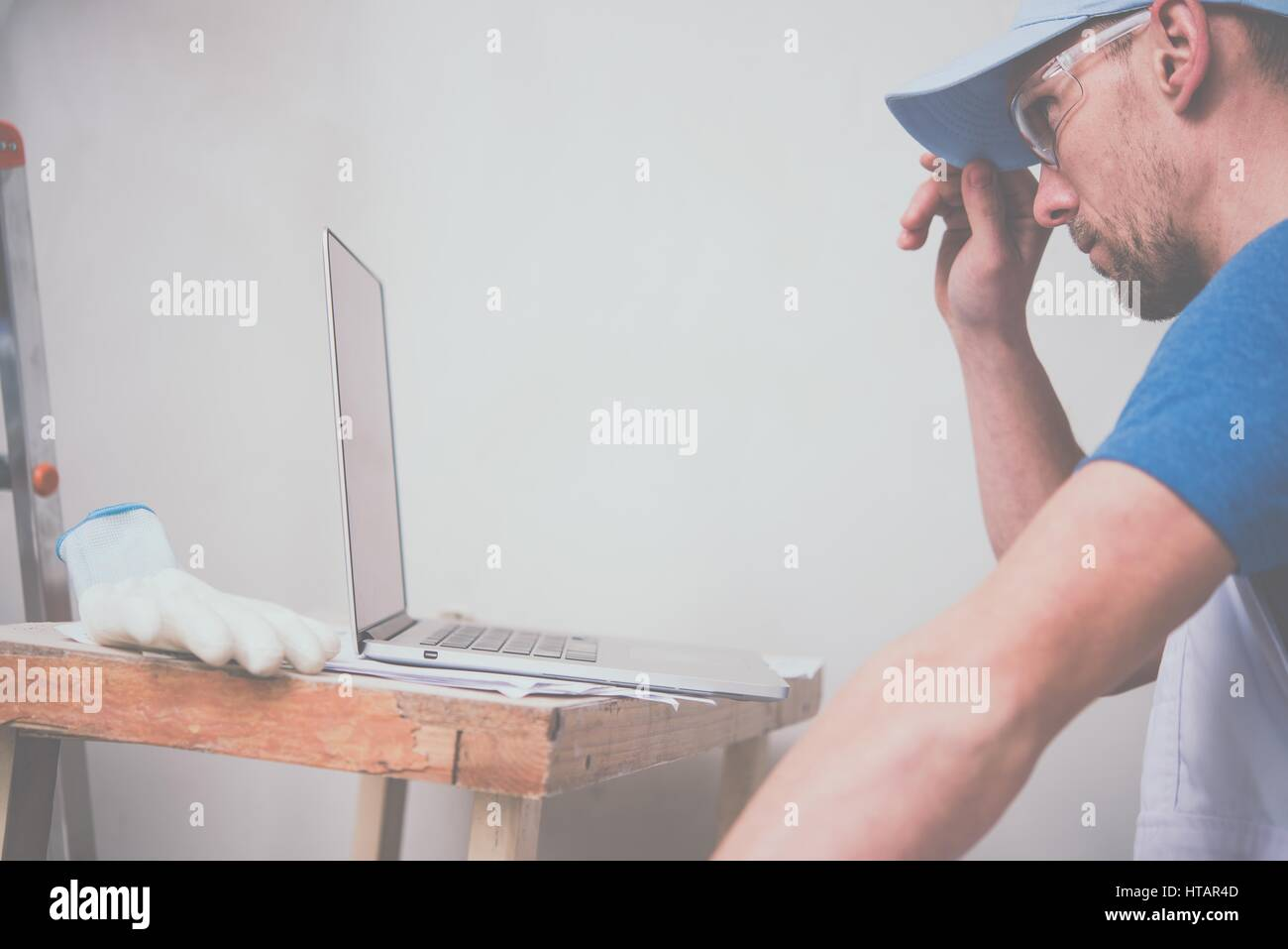 Construction Schedule Laptop Stock Photos   Construction Schedule     Construction Business Concept  Caucasian Worker with Laptop Computer  Checking Project Schedule    Stock Image