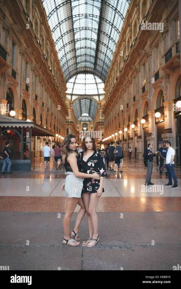 Fashion Capital Of The World Stock Photos   Fashion Capital Of The     Two young women  20 22  pose in front of Vittorio Emanuele ii gallery