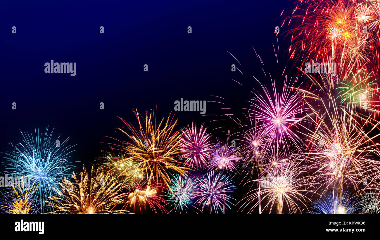 Multi colored fireworks as a border on dark blue background  ideal     Multi colored fireworks as a border on dark blue background  ideal for New  Year or other celebration events