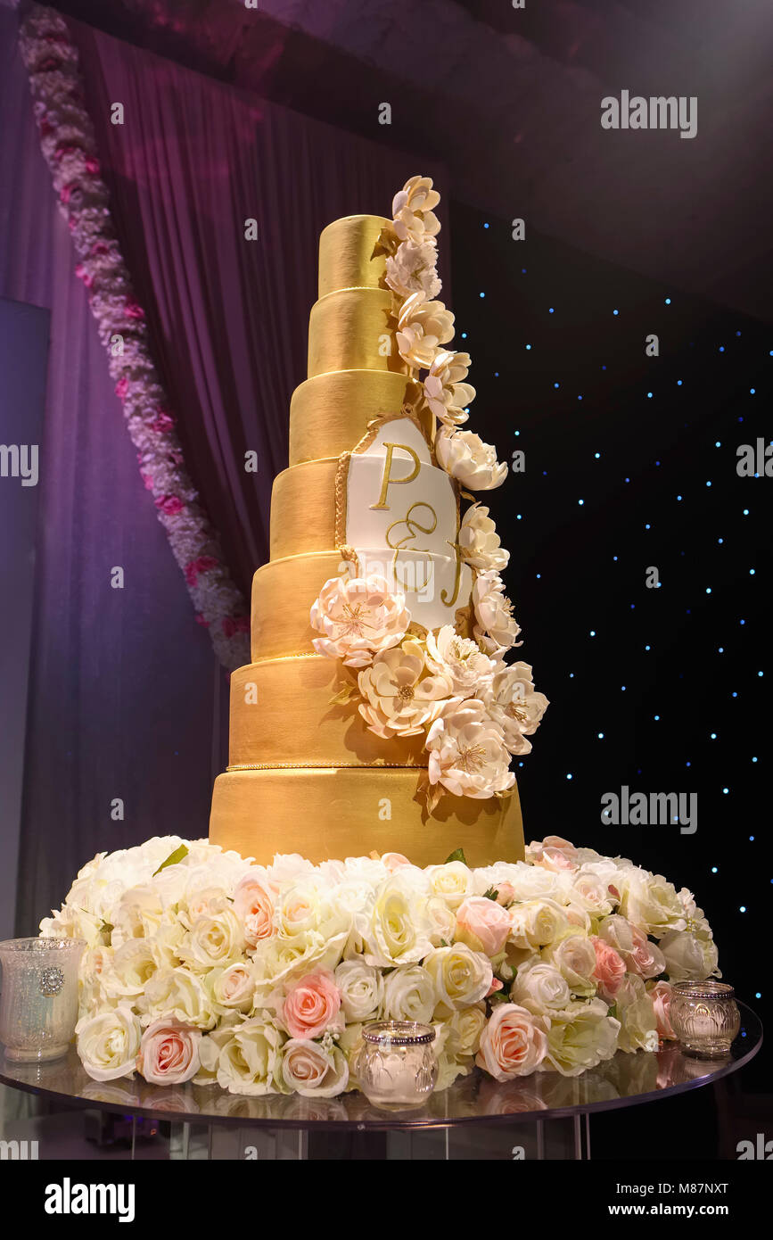 Elaborate tall wedding cake on display at hotel wedding reception     Elaborate tall wedding cake on display at hotel wedding reception