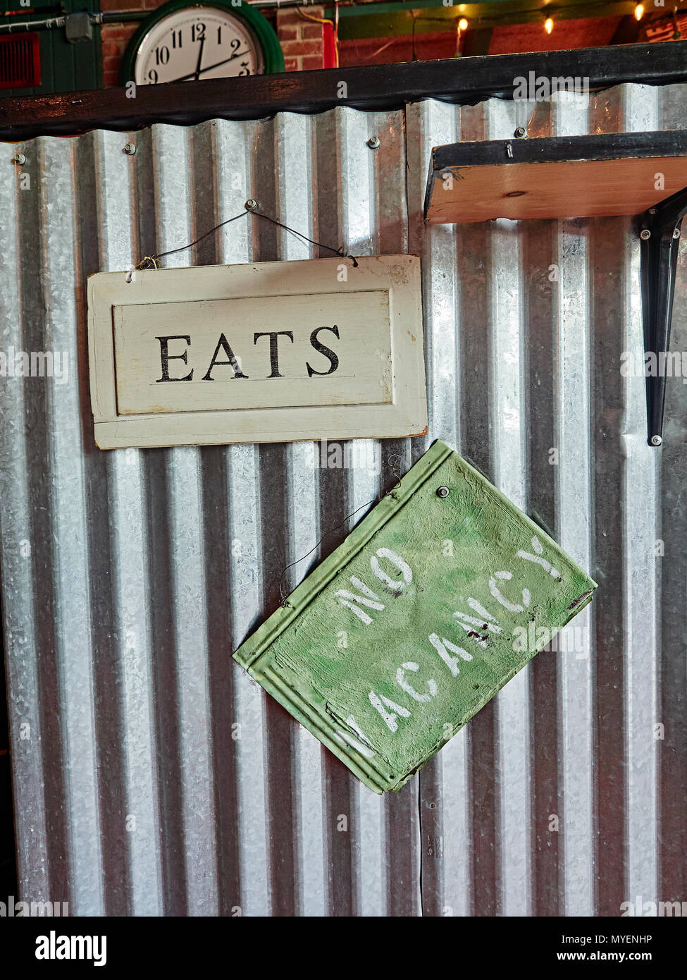 Eats and No Vacancy sign or signs hanging on restaurant wall for     Eats and No Vacancy sign or signs hanging on restaurant wall for interior  design in a hip college town restaurant in Auburn Alabama  USA