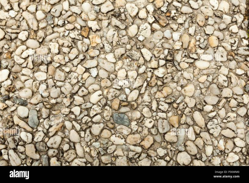Pebble stone floor tile seamless background  Cement mixed gravel     Pebble stone floor tile seamless background  Cement mixed gravel pebble  stone floor texture  Wet round pebble stone rock floor in dramatic lighting
