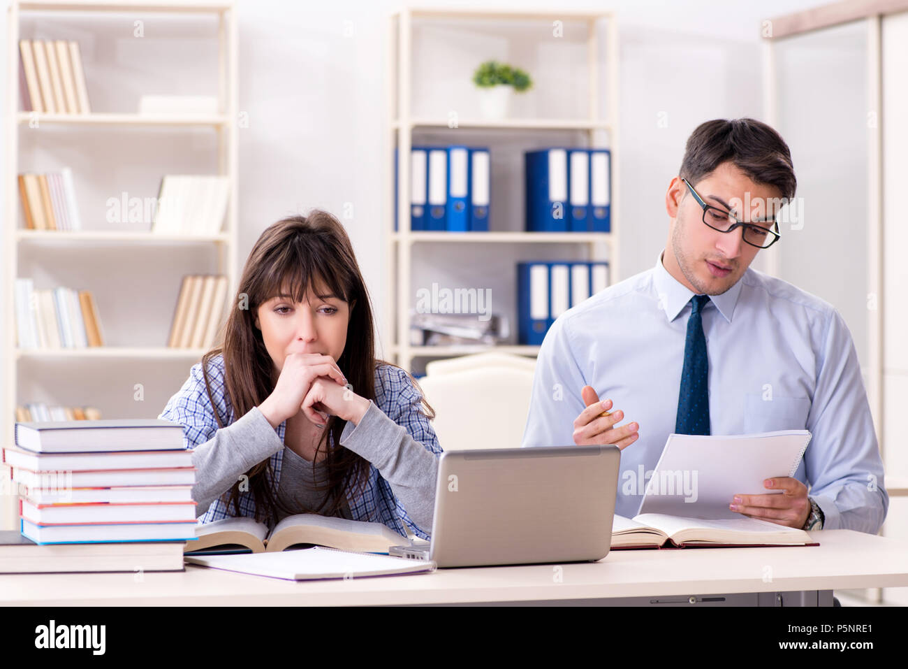 University Exam Invigilator Stock Photos   University Exam     Male lecturer giving lecture to female student   Stock Image