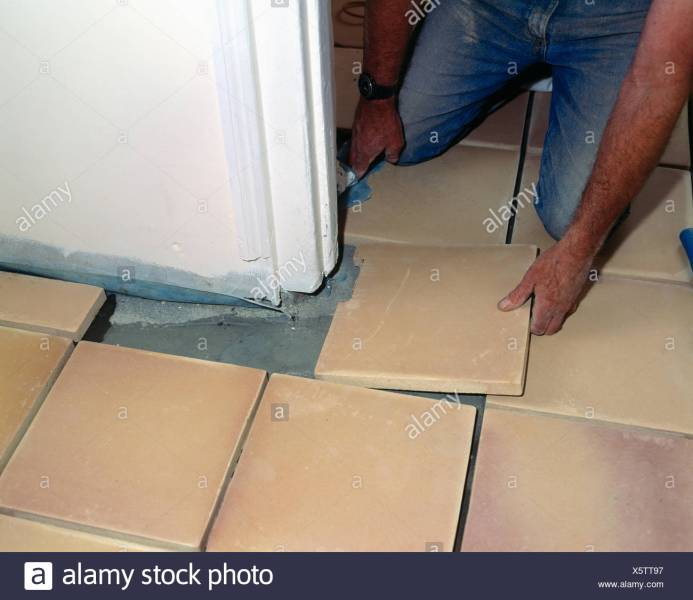 Close up of man laying ceramic floor tiles Stock Photo  278985091     Close up of man laying ceramic floor tiles