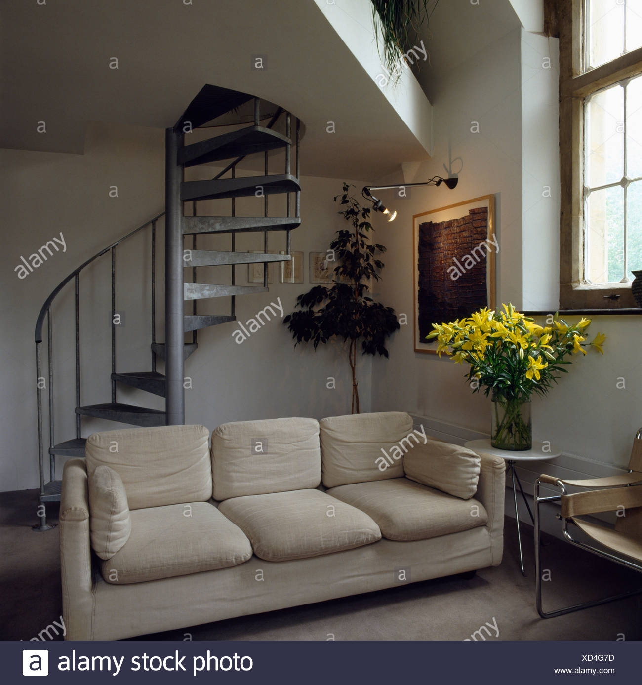 Modern Sofa In Attic Living Room With Spiral Staircase Stock Photo | Spiral Staircase To Attic Bedroom | Loft Bedroom | Tight Space | Design | Before And After | Attic Ladder