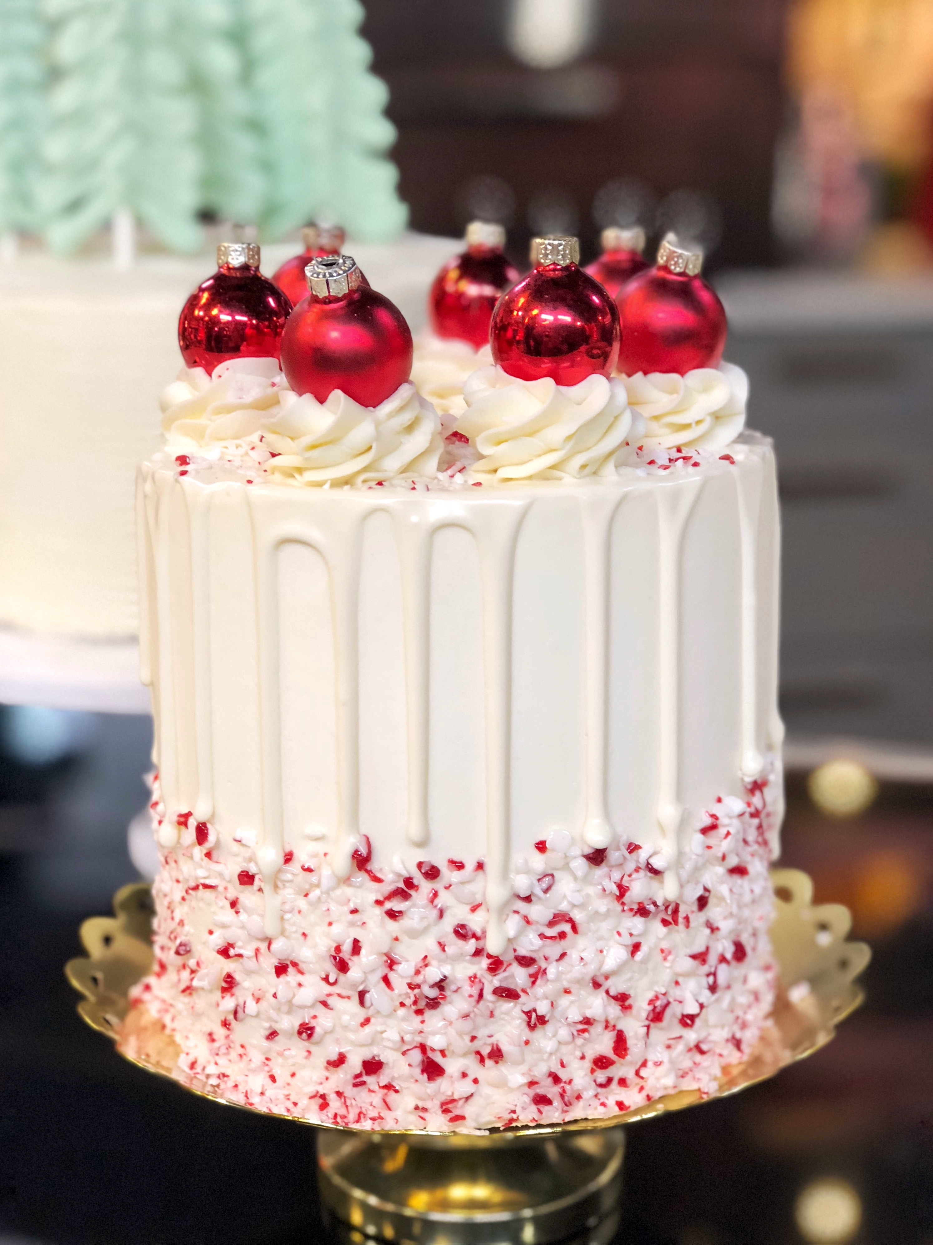 Simple and Cute Christmas Cake Decorating Ideas This cake is so delicious and with some crushed peppermint candies and mini  red ornaments  it s a breeze to decorate