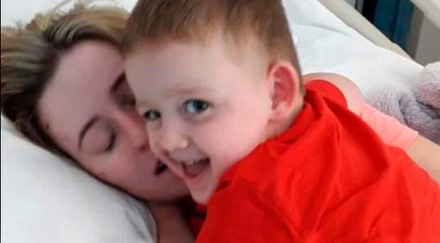 Doctors say it s a miracle I m still alive  says Fermanagh mother     Rachel Elliott and her son Ronnie in hospital