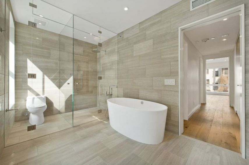 Make a Statement with Large Floor Tiles View in gallery Bathroom with coordinated wall and floor tile
