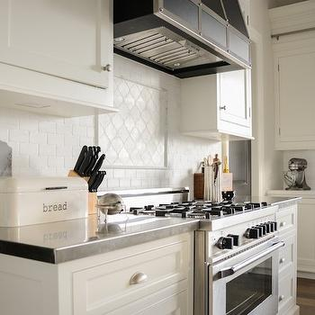 Off White Cabinets With Black Arabesque Tiles