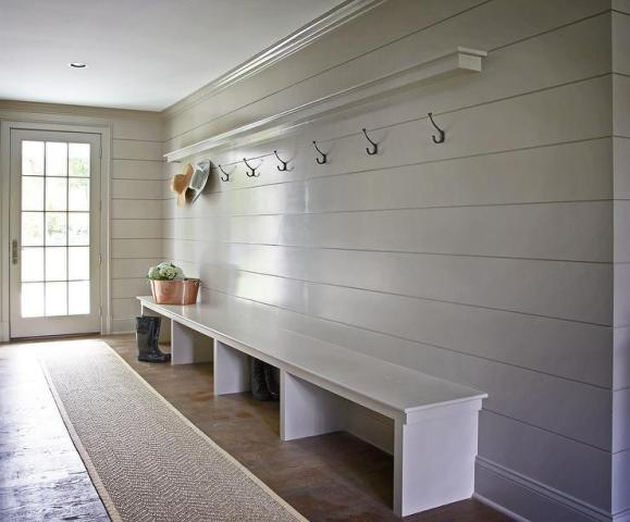 Gray Shiplap Walls Design Ideas Gray mudroom boasts gray shiplap walls lined with a shelf ledge and a row  of hooks over an extra long bench alongside a bound herringbone sisal  runner