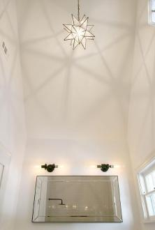 White Bathroom with Vaulted Ceiling and Glass Moravian Star Pendant     White Bathroom with Vaulted Ceiling and Glass Moravian Star Pendant