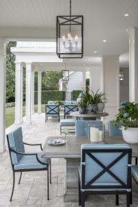Gray Outdoor Dining Table with Wrought iron Dining Chairs and Blue     Gray Outdoor Dining Table with Wrought iron Dining Chairs and Blue Cushions