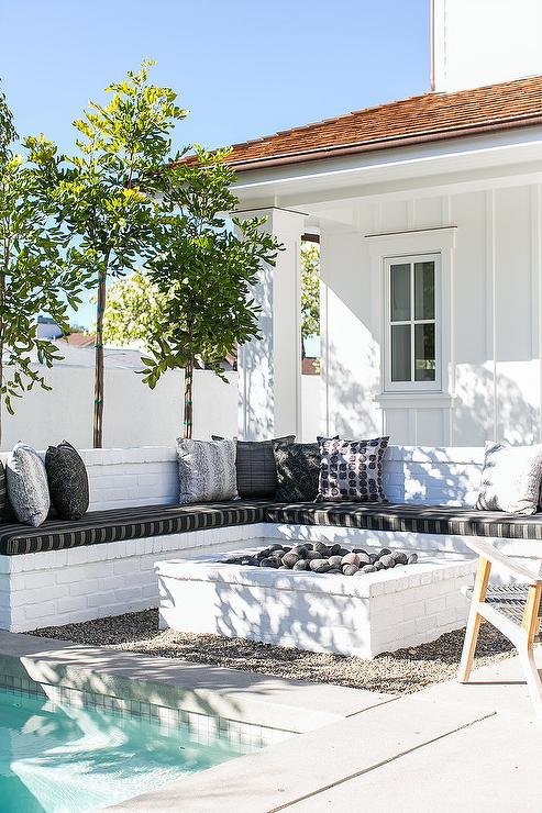 Patio With White Brick Bench And White Brick Fire Pit