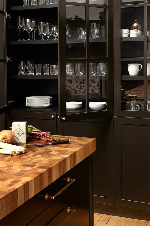 Black Glass Front China Cabinet With White Pottery