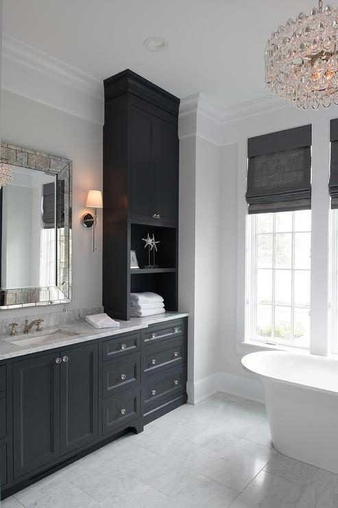 Black And White Master Bathroom With Antiqued Mirror