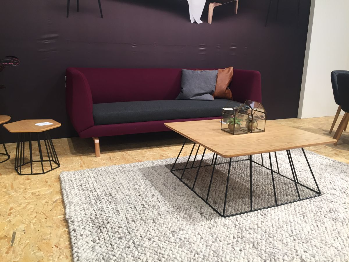 What Is Contemporary Design  Wire base coffee table with purple sofa