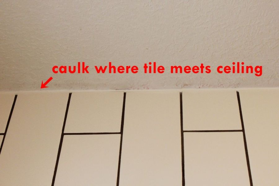 How to Tile a Shower Tub Surround  Part 2  Grouting  Sealing  and     Caulk the space between tile and ceiling