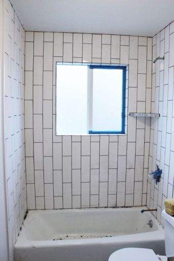 How to Tile a Shower Tub Surround  Part 2  Grouting  Sealing  and     DIY Grout Shower Tub Surround Tape