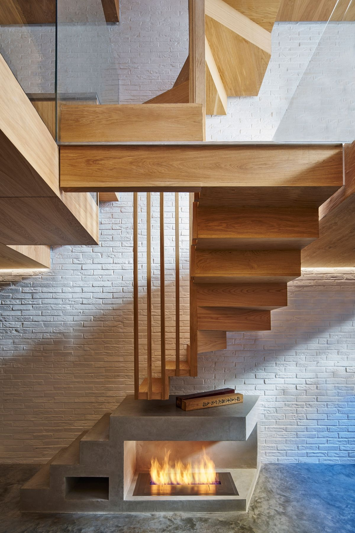 Cool Staircase Designs Guaranteed To Tickle Your Brain   Concrete And Wood Stairs   Concrete Wall   Separated   Concrete Building Interior   Glass Balustrade   White Riser Wood