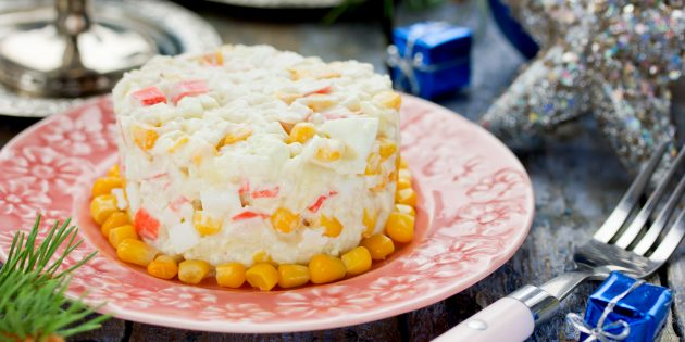 Salad recipe with crab chopsticks, rice, corn, eggs and cheese