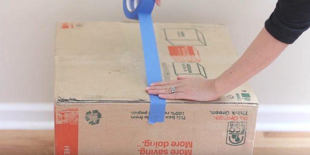 Hus til katten gør det selv: Rengør sømmen i bunden af den første boks