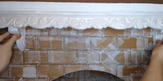 Decorative fireplace with their own hands: Stick decorative corners to imitate